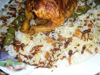 دجاج مشوي بالفرن مع رزأبيض بخلطة البصل والزبيب بالصور hayahcc_1375823438_260.png