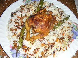 دجاج مشوي بالفرن مع رزأبيض بخلطة البصل والزبيب بالصور hayahcc_1375823438_997.png