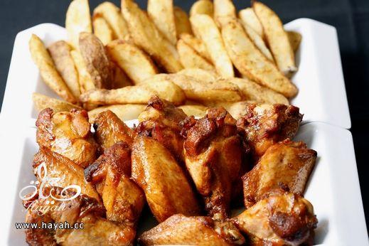 أجنحة الدجاج المقرمشه مع البطاطس وكريمة الثوم hayahcc_1390483696_381.jpg