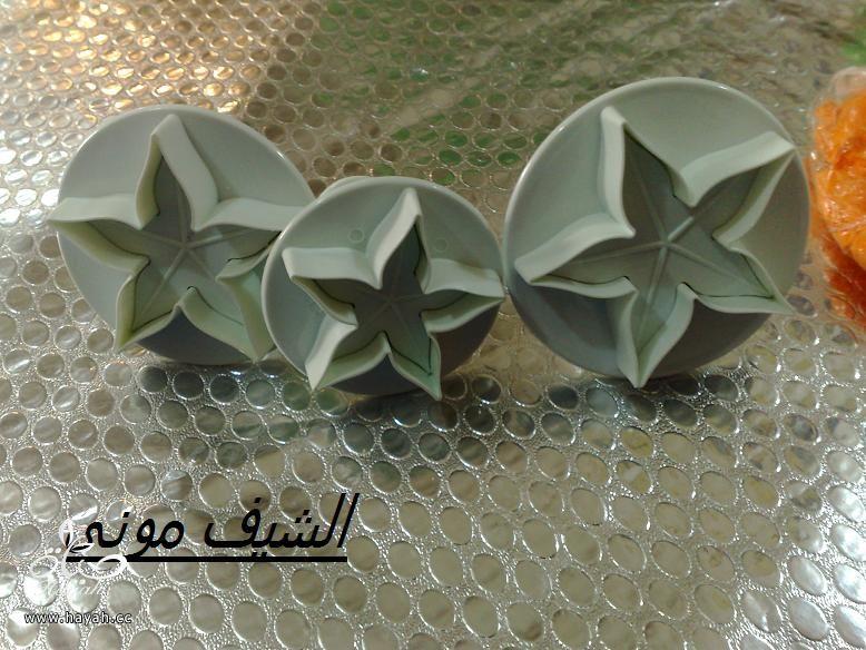 تورتة السبت ووردات الفوندان الملونة من مطبخ الشيف مونى بالصور hayahcc_1398602841_649.jpg