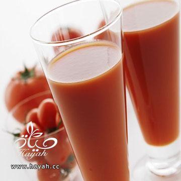 أزيل الكرش بعصير الطماطم hayahcc_1425556017_553.jpg