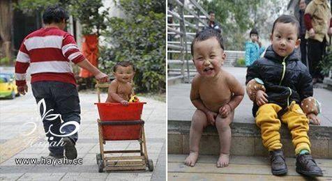 صيني يمنع طفله من الملابس لتعليمه الجرأة hayahcc_1427010793_406.jpg