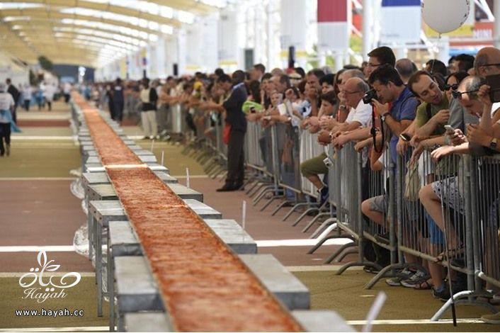 ايطاليا تصنع أطول بيتزا بالعالم hayahcc_1434887841_432.jpg