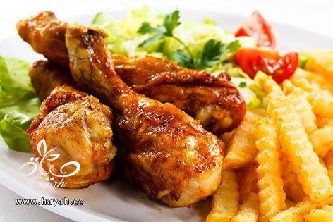 طريقة عمل أفخاذ الدجاج المغطاة بالعسل hayahcc_1442075395_812.jpg