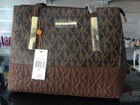 أفخم الحقائب النسائية بألوان ترابية hayahcc_1442733039_501.jpg